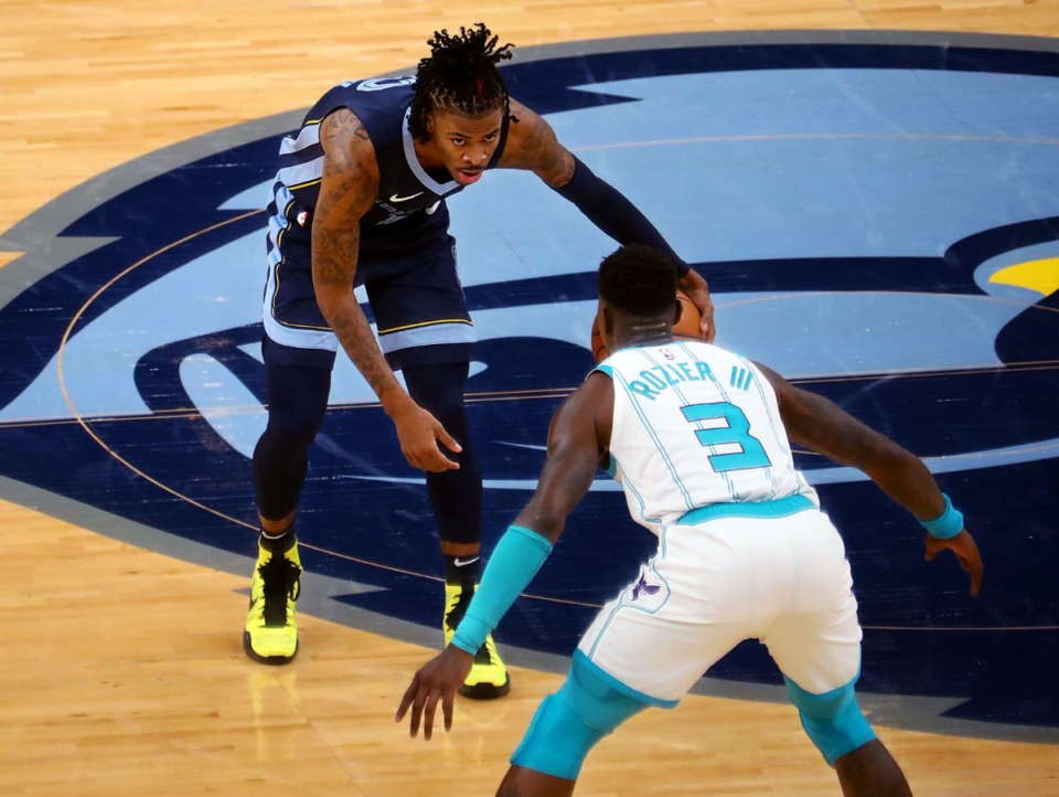 <strong>Memphis Grizzles guard Ja Morant (2) stares down Charlotte Hornets guard Terry Rozier (3) during a Feb. 10, 2021 game at the FedExForum.</strong> (Patrick Lantrip/Daily Memphian)