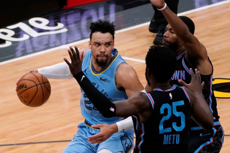 <strong>Memphis Grizzlies guard Dillon Brooks, left, is double-teamed by Sacramento Kings' Chimezie Metu (25) and Glenn Robinson III during the second half of an NBA basketball game in Sacramento, California, Sunday, Feb. 14, 2021. The Grizzlies won 124-110.</strong> (AP Photo/Rich Pedroncelli)