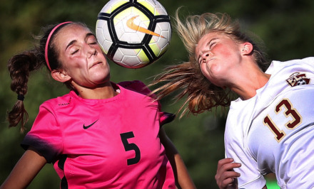 <strong>The Mustang's Sydney Somogyi (5) battles for control of a header against Phoebe Harpole (13) from ECS during Houston High School's soccer game against ECS in August 2018.</strong> (Jim Weber/Daily Memphian file)