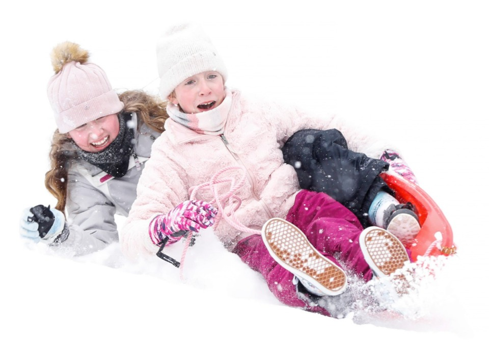 <strong>Evans Ragin, 12, (front) and Gemma Ferguson, 12, (back) crash while sledding down a hill during a heavy snow in Overton Park on Monday, Feb. 15, 2021.</strong> (Mark Weber/The Daily Memphian)