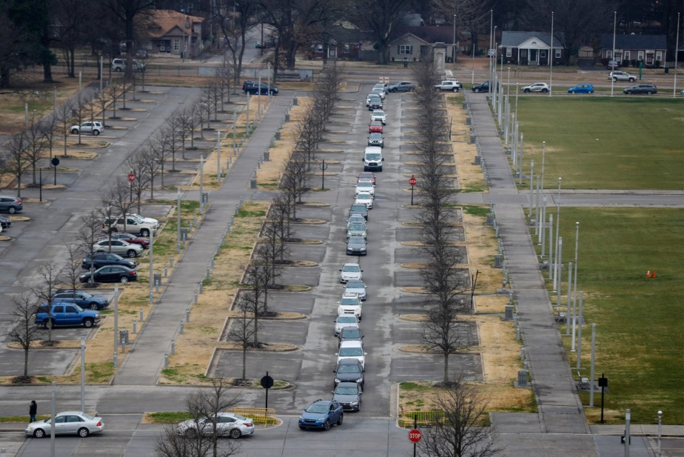 <strong>Hundreds of cars snake their way though the parking lots at Tiger Lane on Wednesday, January 27, 2021 while waiting to receive the COVID-19 vaccine inside the Pipkin Building.</strong> (Mark Weber/The Daily Memphian)