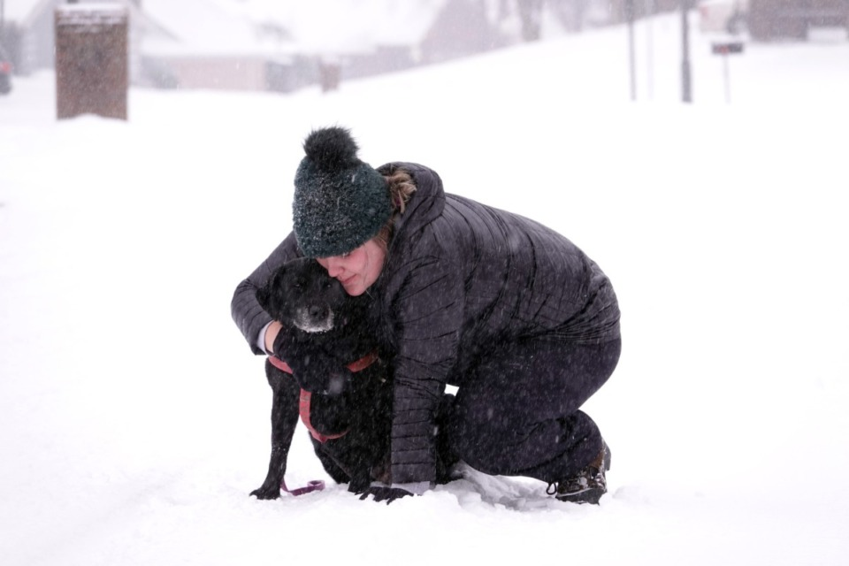 <strong>Jessica Focht tries to coax her dog, Bella, to go back home while out on a walk in Cordova, Monday afternoon Feb. 15, 2021.</strong> (Karen Pulfer Focht/Special To The Daily Memphian)