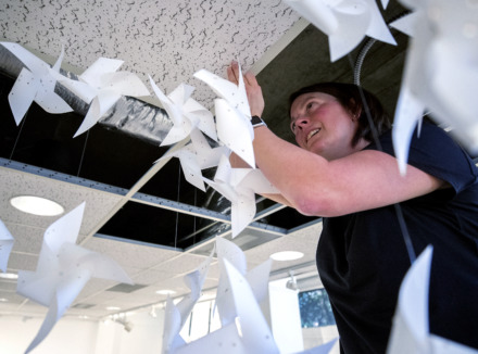 "<strong>Memphis artist Katie Maish installs her exhibition ""Labor"" inside the Beverly & Sam Ross Gallery at Christian Brothers University on Tuesday, Jan. 8, 2019. Maish's work focuses on papercraft, including paper-cut pinwheels suspended from the ceiling.</strong> (Houston Cofield/Daily Memphian)"