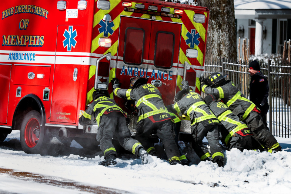 <strong>Memphis Firefighters rescue an ambulance stuck in snow and ice on Walnut Grove Rd., on Tuesday, Feb. 16, 2021.</strong> (Mark Weber/The Daily Memphian)