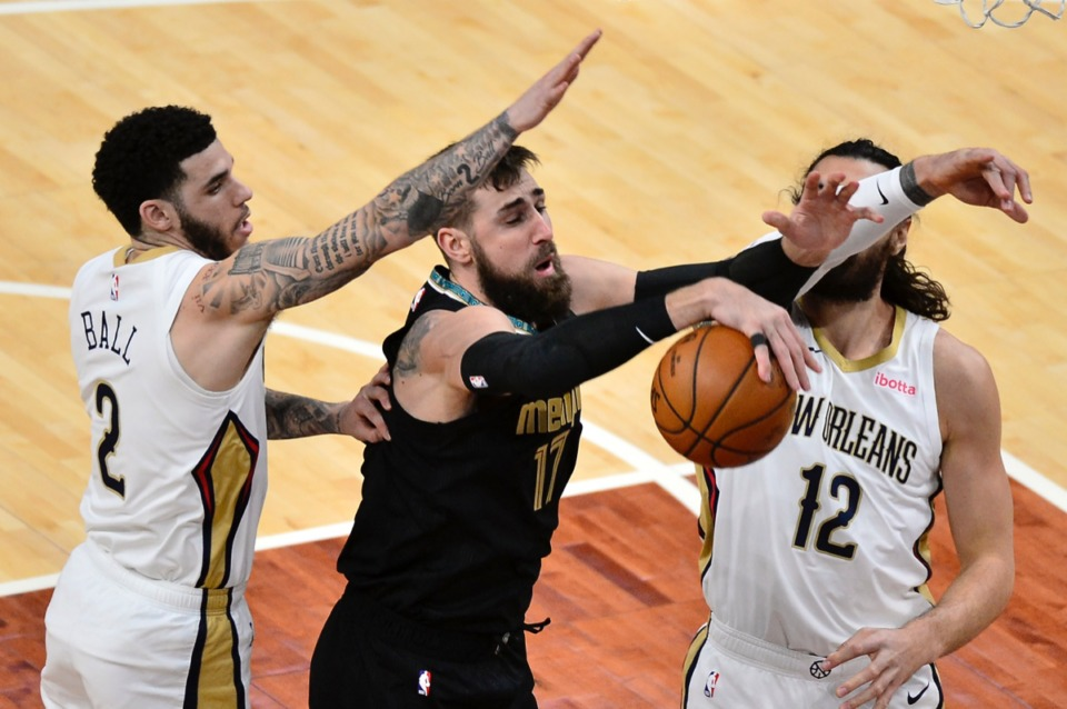 <strong>Grizzlies center Jonas Valanciunas (17) struggles for control of the ball with New Orleans Pelicans guard Lonzo Ball (2) and center Steven Adams (12) on Feb. 16, 2021, at FedExForum.</strong> (Brandon Dill/AP)