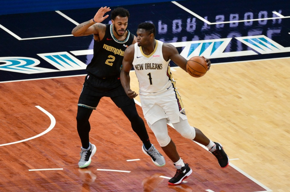 <strong>New Orleans Pelicans forward Zion Williamson (1) is defended by Grizzlies center Xavier Tillman Sr. (2) at FedExForum on Feb. 16.</strong> (Brandon Dill/AP)
