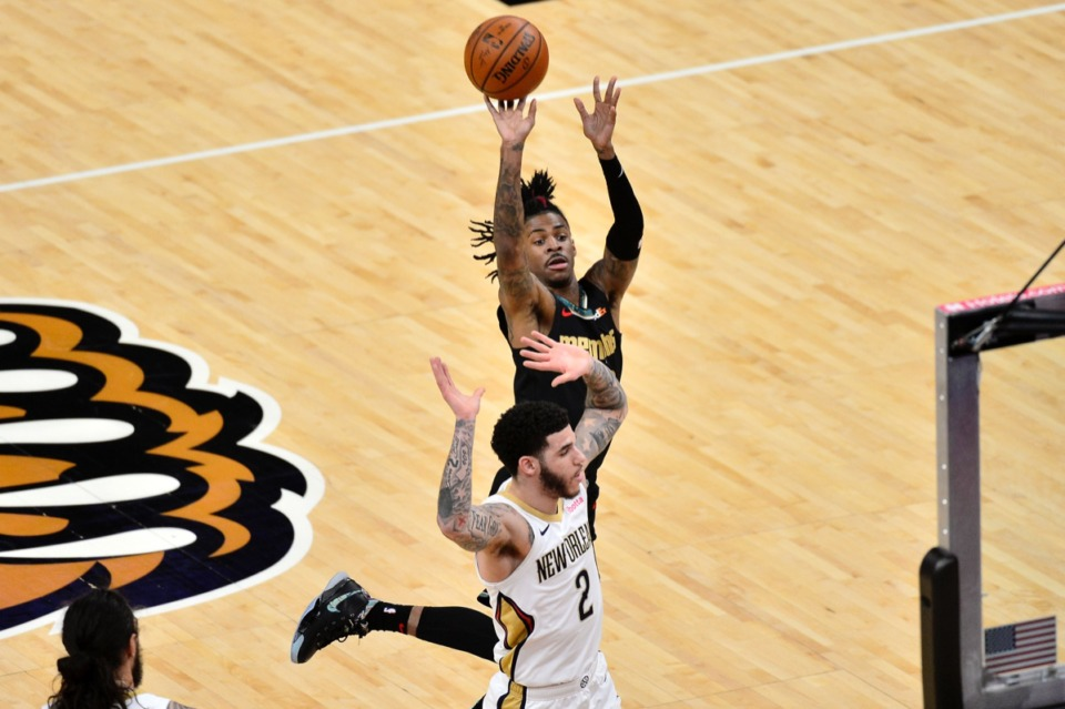 <strong>Grizzlies guard Ja Morant shoots over New Orleans Pelicans guard Lonzo Ball (2) on Feb. 16, 2021, at FedExForum.</strong> (Brandon Dill/AP)