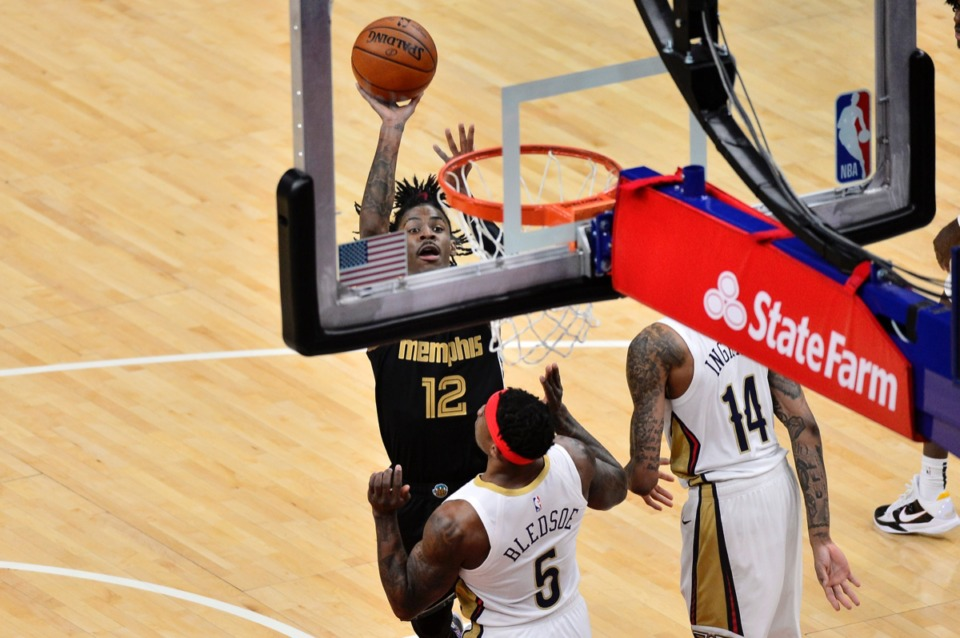 <strong>Grizzlies guard Ja Morant (12) shoots over New Orleans Pelicans guard Eric Bledsoe (5) at FedExForum on Feb. 16.</strong> (Brandon Dill/AP)
