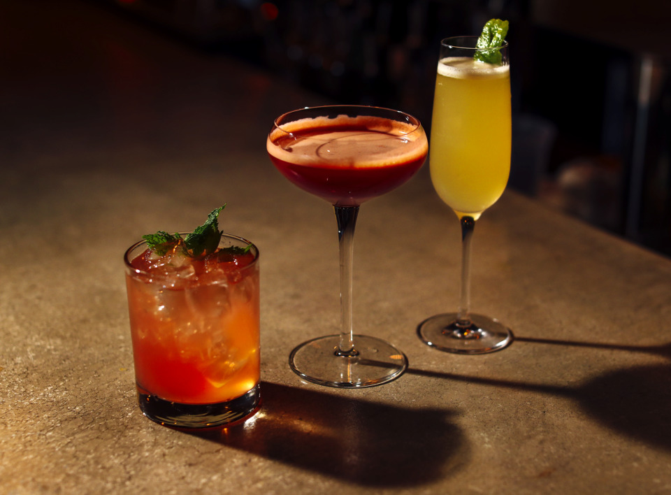 <strong>The Pink Flag (from left), Trinidad Sour and Minor Threat are just a few of the craft cocktails available at P.O. Press Public House & Provisions.</strong> (Houston Cofield/Daily Memphian)