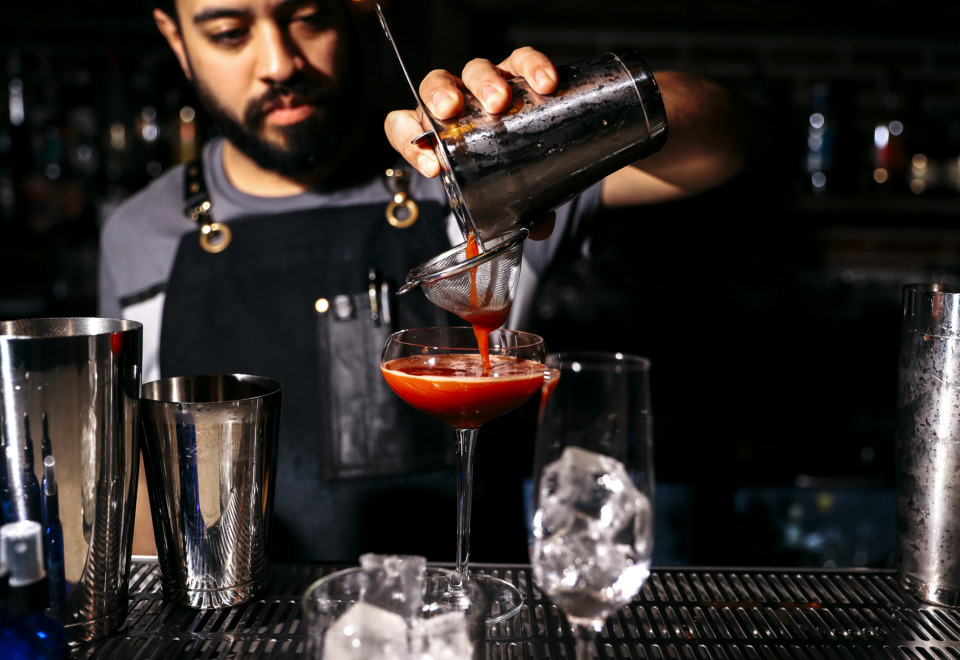 <strong>P.O. Press Public House &amp; Provisions bartender Nick Manlavi pours a Trinidad Sour, one of the craft cocktails available on the restaurant's creative drink menu.</strong> (Houston Cofield/Daily Memphian)