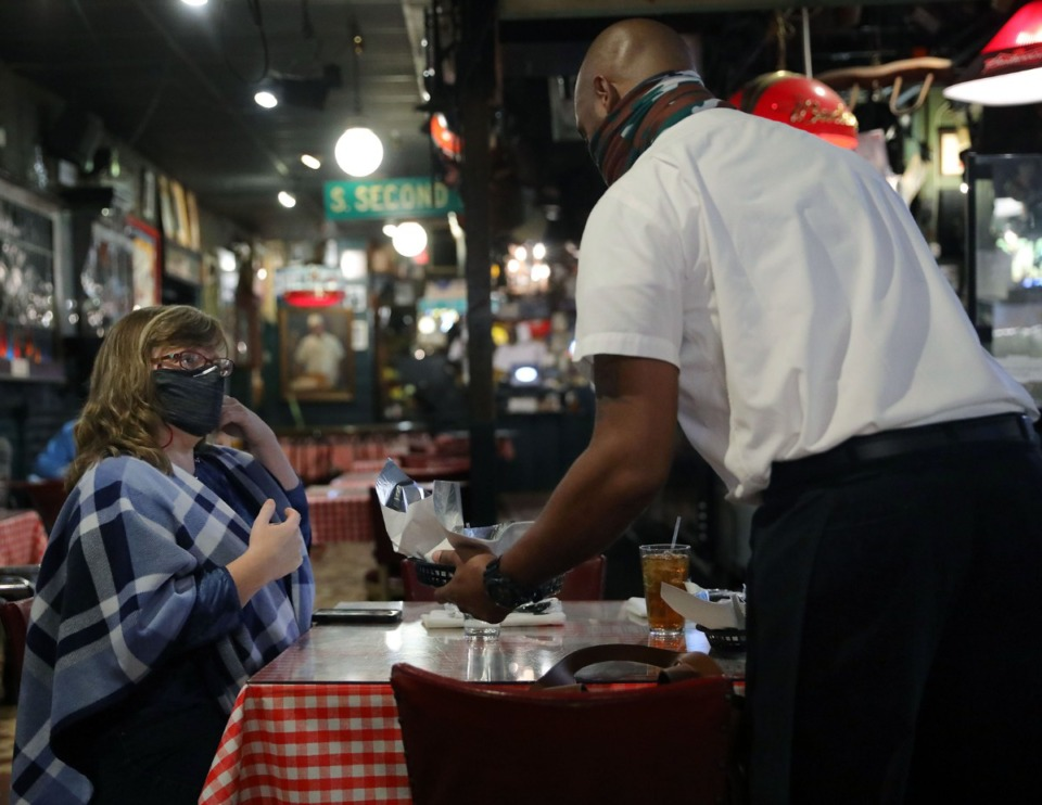 <strong>Denise Tate gets a plate of ribs for lunch at Rendezvous Dec. 1, 2020.</strong> (Patrick Lantrip/Daily Memphian file)
