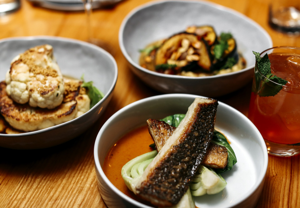 <strong>Red fish with bok choy and miso-curry is one of the popular dishes on P.O. Press Public House & Provision's menu.</strong> (Houston Cofield/Daily Memphian)