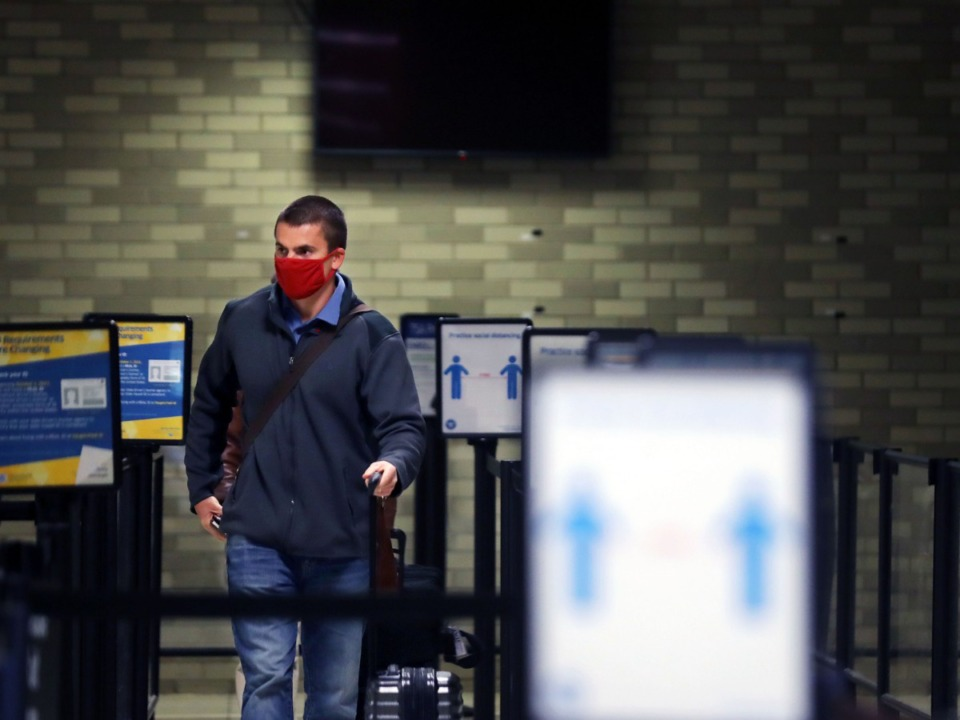 <strong>A passenger gets in line at the TSA checkpoint at Memphis International Airport in December.</strong> (Patrick Lantrip/Daily Memphian file)
