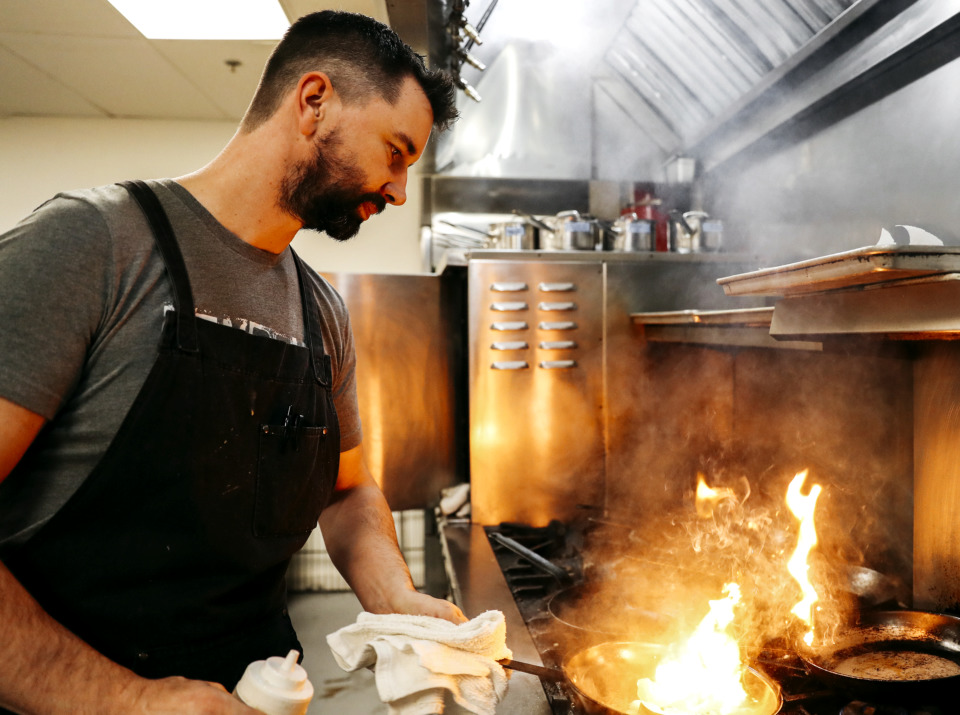 <strong>Jimmy Gentry, chef and co-owner of P.O. Press Public House &amp; Provisions, prepares some bacon to serve as a topping for an entree.</strong> (Houston Cofield/Daily Memphian)