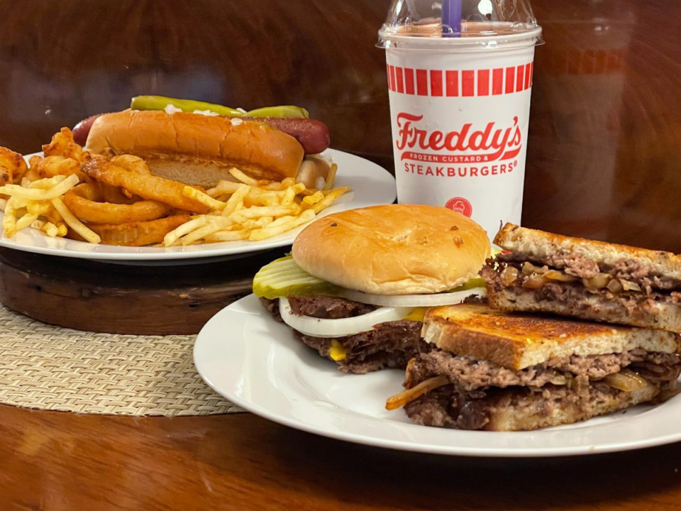 <strong>Freddy&rsquo;s Frozen Custard &amp; Steakburgers offers (from left) the Chicago Dog, Freddy&rsquo;s Original Double and Freddy&rsquo;s Original Patty Melt.</strong>&nbsp;(Jennifer Biggs/Daily Memphian)