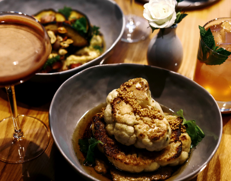 <strong>Cauliflower served at P.O. Press Public House & Provisions is grilled and topped with brown butter and a garlic puree. The restaurant, located off the square in Collierville, has been open since October 2018 and serves new American farm-to-table fare.</strong> (Houston Cofield/Daily Memphian)