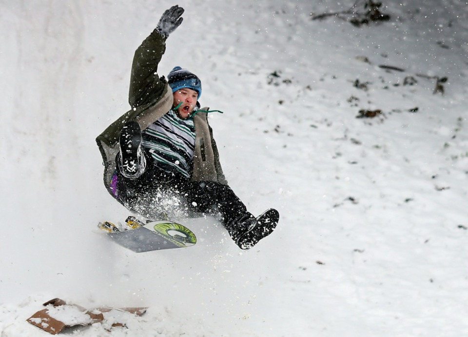 <strong>Carl Harrell rides his snowboard off of a ramp at the bottom of the Mississippi River Bluffs in Downtown Memphis on Wednesday, Feb. 17.</strong> (Patrick Lantrip/Daily Memphian)