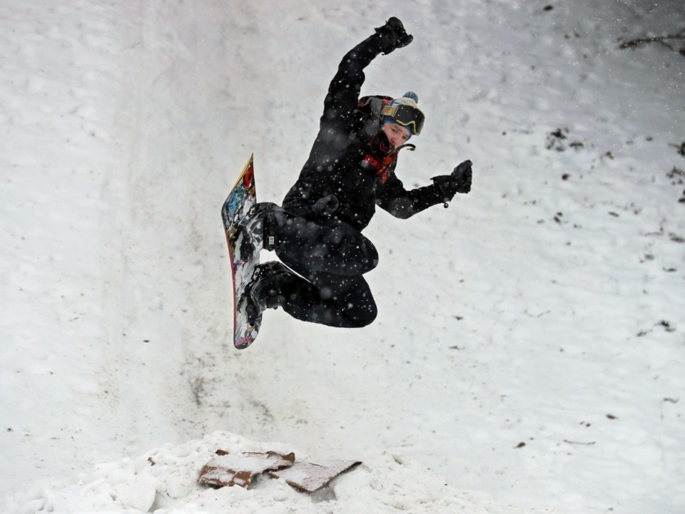 <strong>Beau Bowden hits a jump at the bottom of the Mississippi River Bluffs in Downtown Memphis on Wednesday, Feb. 17.</strong> (Patrick Lantrip/Daily Memphian)