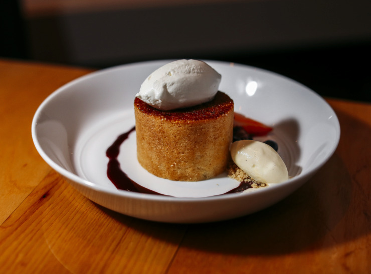 <strong>The buttercake dessert, served with a brulee crust and a scoop of gelato, is prepared daily – except Sunday – by pastry chef Derek Buchanan at P.O. Public House & Provision's menu.</strong> (Houston Cofield/Daily Memphian)