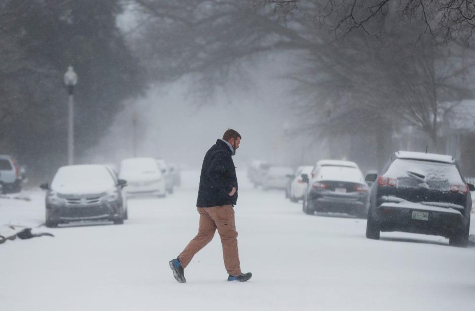 <strong>A man walks through falling sleet on Monday, Feb. 15, 2021 in Midtown.</strong> (Mark Weber/The Daily Memphian)