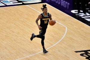 <strong>Grizzlies guard Ja Morant (12), seen here playing against the Pelicans Feb. 16, made strong runs in the last two quarters against the Thunder Wednesday night. Morant finished with 15 points, 12 assists and 11 rebounds for his third career triple-double.</strong> (Brandon Dill/AP file)