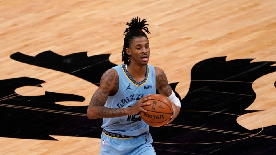 <strong>Memphis Grizzlies guard Ja Morant passes during the second half of a game against the Sacramento Kings on Feb.14, 2021. </strong>(Rich Pedroncelli/AP)