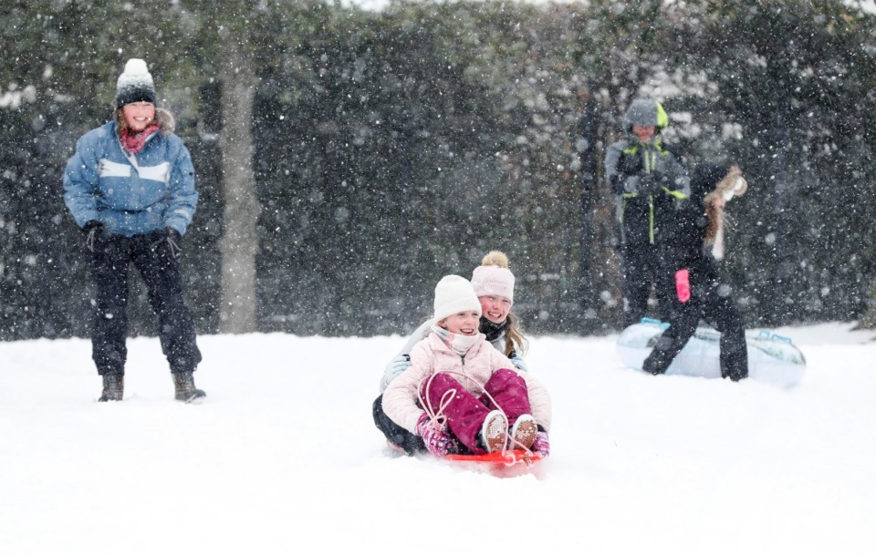 <strong>Evans Ragin, 12, (front) and Gemma Ferguson, 12, (back) slide down a hill in Overton Park on Monday, Feb. 15.</strong> (Mark Weber/Daily Memphian)