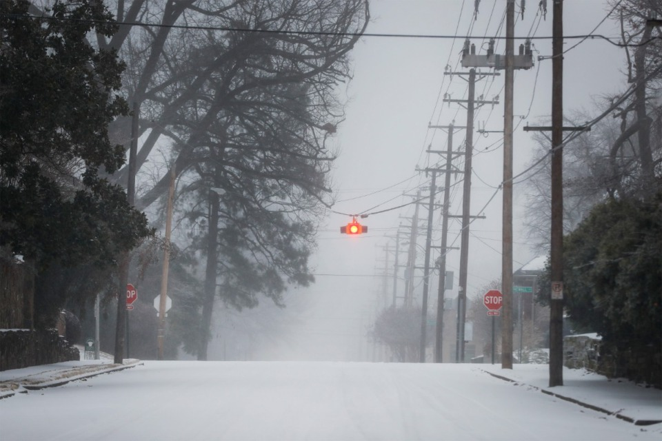<strong>Sleet glazes streets in Midtown on Monday, Feb. 15.</strong> (Mark Weber/Daily Memphian)