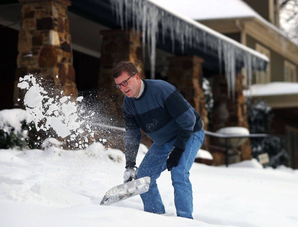 <strong>Sandy Webb shovels snow off of the steps on his Midtown home Feb. 18, 2021.</strong> (Patrick Lantrip/Daily Memphian)