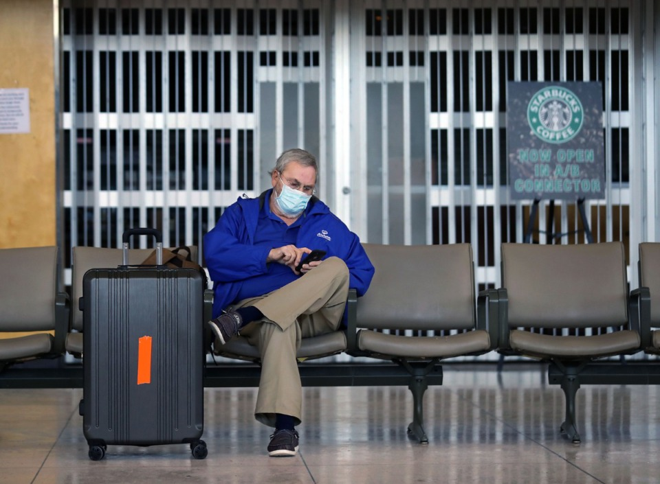 <strong>Buck King sits alone in a near-empty Memphis International Airport on Friday, Feb. 19. King drove more than 100 miles from Iuka, Miss., to catch a flight to Las Vegas for work before learning that his flight was canceled.</strong> <strong>Ongoing systemwide water pressure issues with Memphis Light, Gas and Water Division forced the airport to cancel all flights Friday.</strong> (Patrick Lantrip/Daily Memphian)