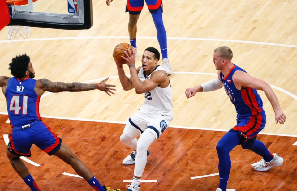 <strong>Grizzlies guard Desmond Bane (middle) drives to the basket against Detroit&rsquo;s Saddiq Bey (left) and Mason Plumlee (right) on Feb. 19, 2021.</strong> (Mark Weber/The Daily Memphian)