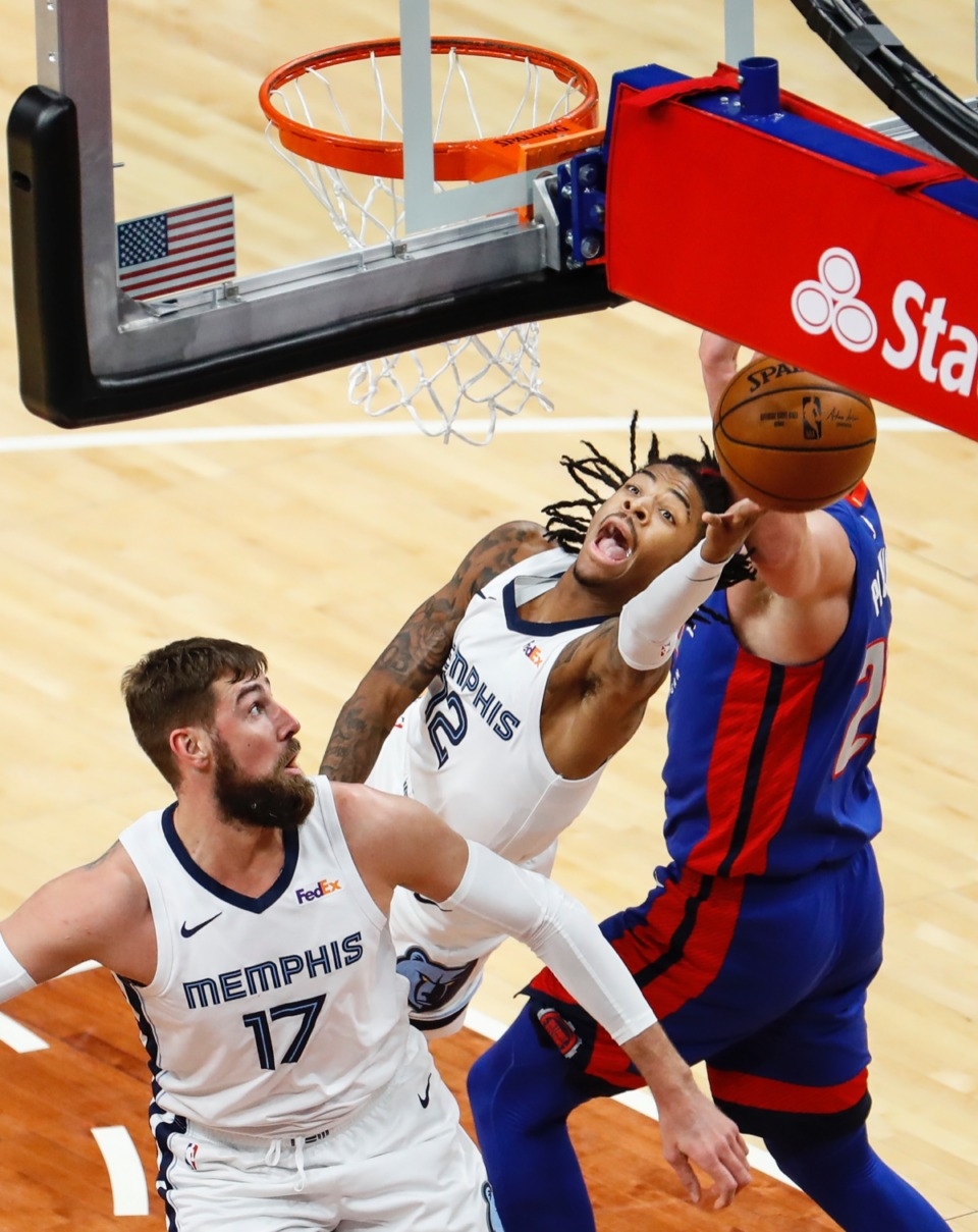 <strong>Grizzlies guard Ja Morant (middle) drives for a layup against the Detroit Pistons on Friday, Feb. 19, 2021.</strong> (Mark Weber/The Daily Memphian)
