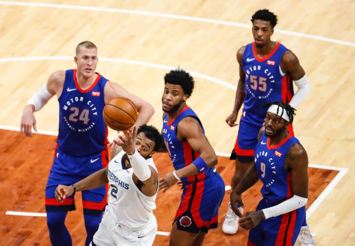 <strong>Grizzlies forward Xavier Tillman Sr. (bottom) tries to grab a rebound against the Detroit Pistons on Friday, Feb. 19, 2021.</strong> (Mark Weber/The Daily Memphian)