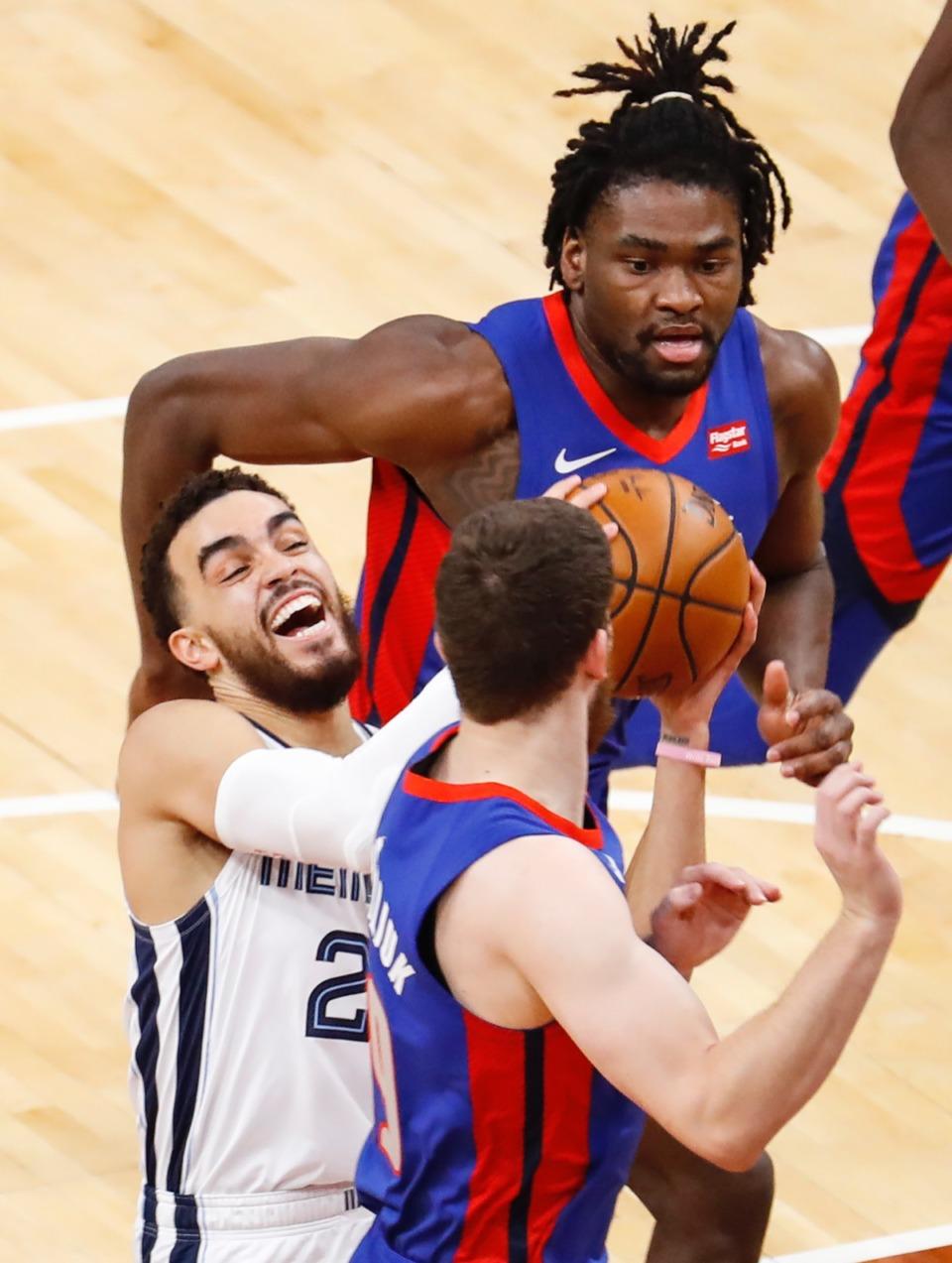 <strong>Grizzlies guard Tyus Jones (left) drives the lane against the Detroit Pistons on Friday, Feb. 19, 2021.</strong> (Mark Weber/The Daily Memphian)