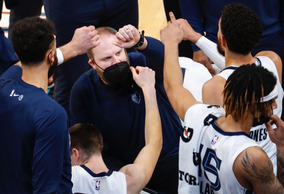 <strong>Grizzlies head coach Tyler Jenkins (middle) talks to his team during the game against the Detroit Pistons on Friday, Feb. 19, 2021.</strong> (Mark Weber/The Daily Memphian)