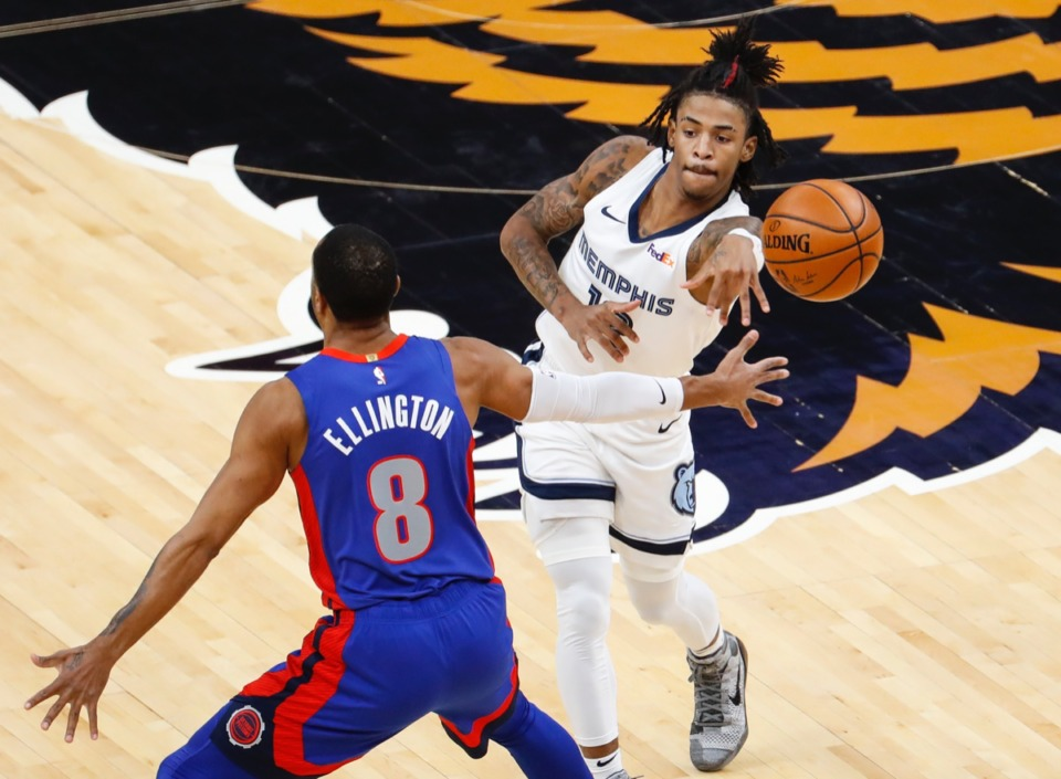 <strong>Grizzlies guard Ja Morant (right) makes a pass on Feb. 19, 2021. He scored 29 points against the Detroit Pistons.</strong> (Mark Weber/The Daily Memphian)