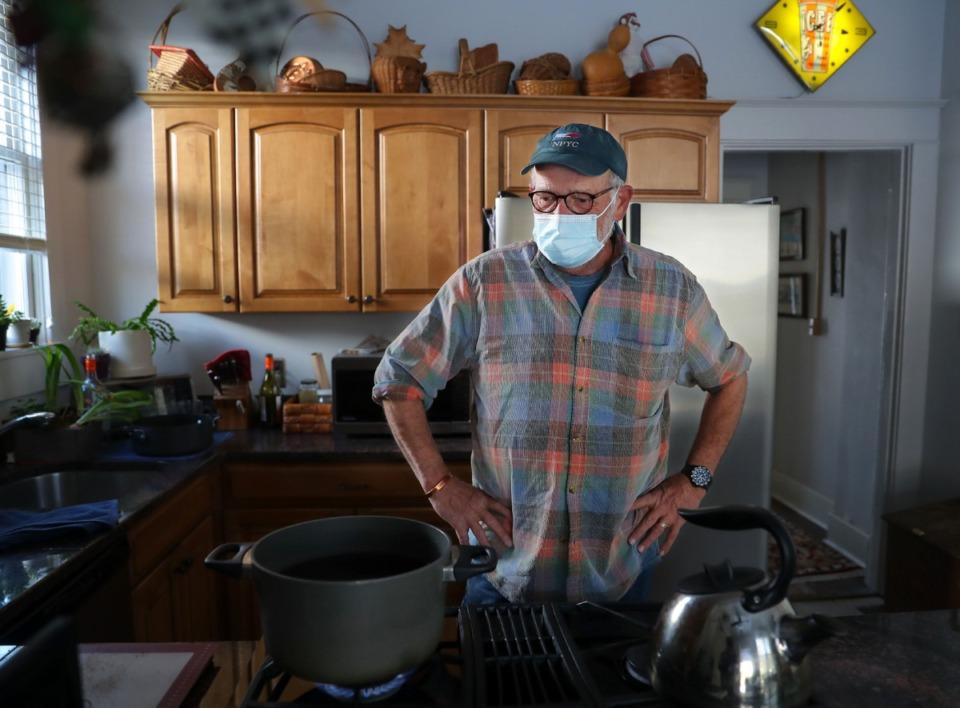 <strong>Roy Haithcock boils water for consumption at his Central Gardens home Feb. 19, 2021.</strong> (Patrick Lantrip/Daily Memphian)