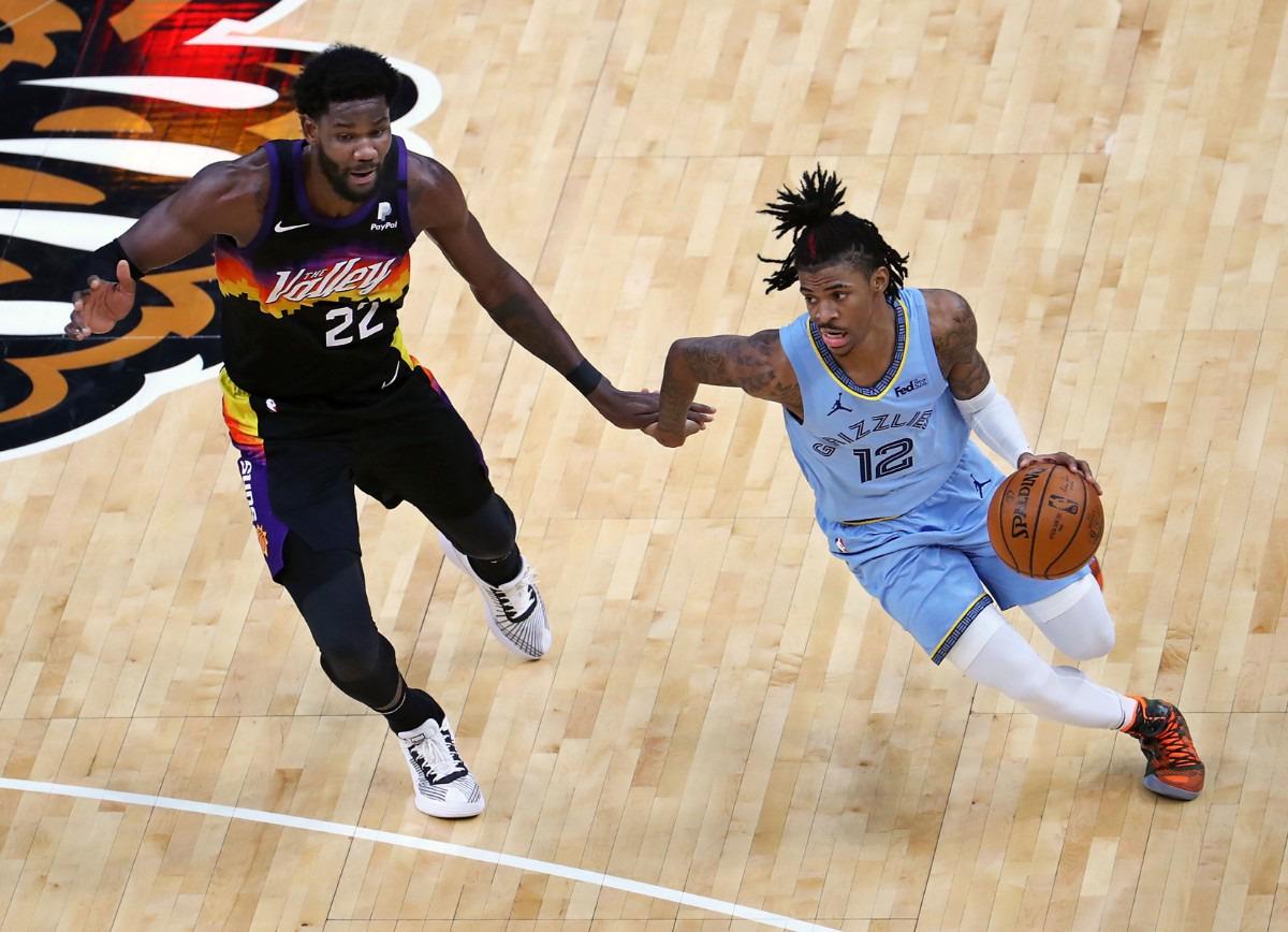 <strong>Memphis Grizzlies guard Ja Morant (12) brings the ball up the court against Phoenix Suns center Deandre Ayton (22) during a Feb. 20, 2021 game at the FedExForum.</strong> (Patrick Lantrip/Daily Memphian)