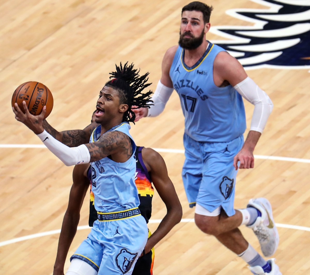 <strong>Memphis Grizzlies guard Ja Morant (12) lays the ball up during a Feb. 20, 2021 game against the Phoenix Suns at the FedExForum.</strong> (Patrick Lantrip/Daily Memphian)