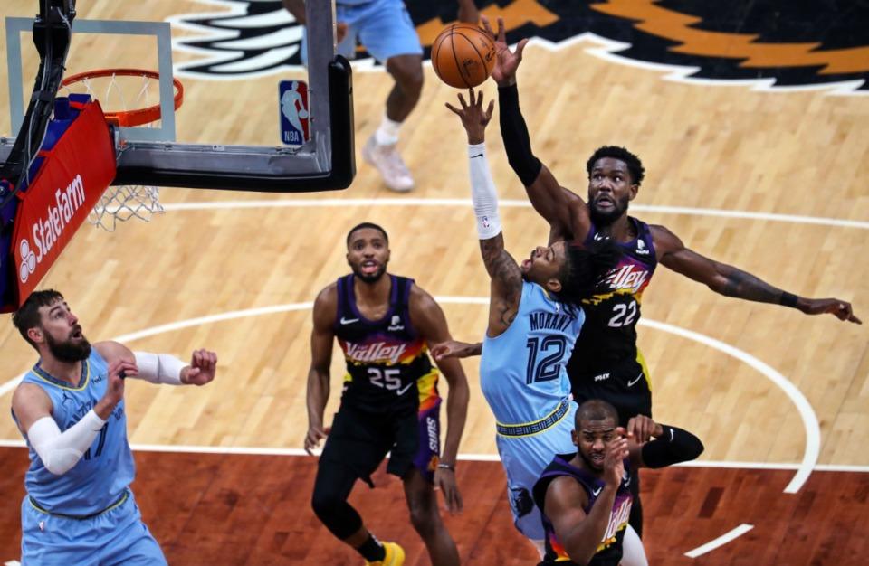 <strong>Memphis Grizzlies guard Ja Morant (12) drives to the basket against Phoenix Suns center Deandre Ayton (22) during a Feb. 20, 2021 game at the FedExForum.</strong> (Patrick Lantrip/Daily Memphian)