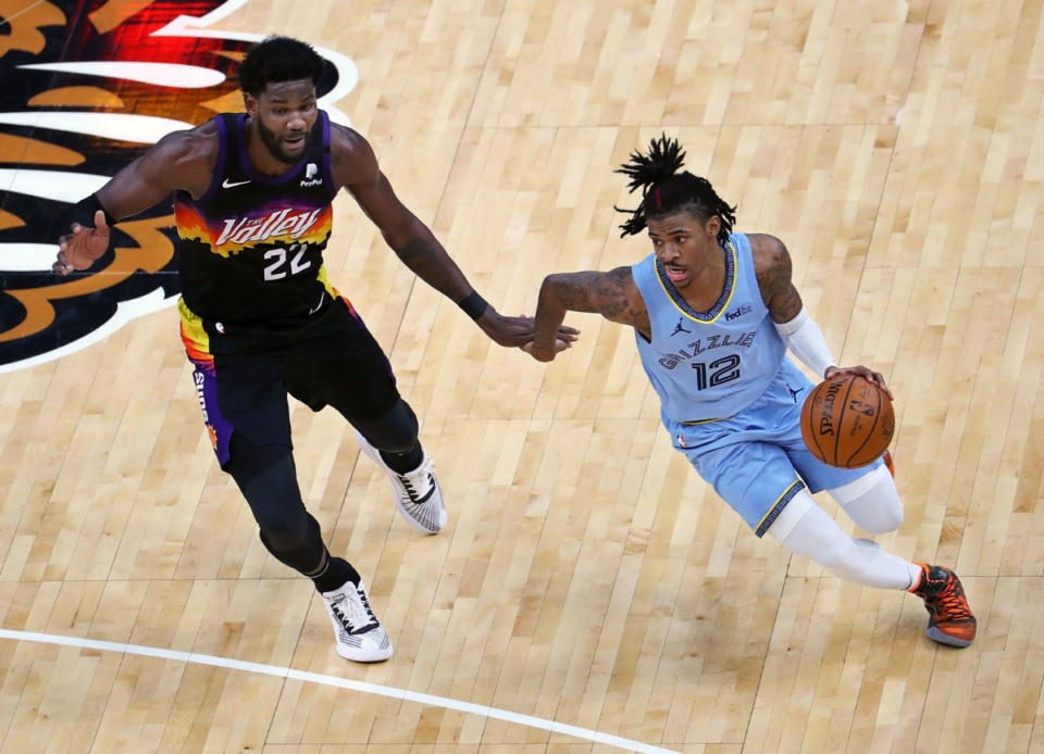 <strong>Memphis Grizzlies guard Ja Morant (12) brings the ball up the court against Phoenix Suns center Deandre Ayton (22) during a Feb. 20, 2021 game at the FedExForum. (</strong>Patrick Lantrip/Daily Memphian)