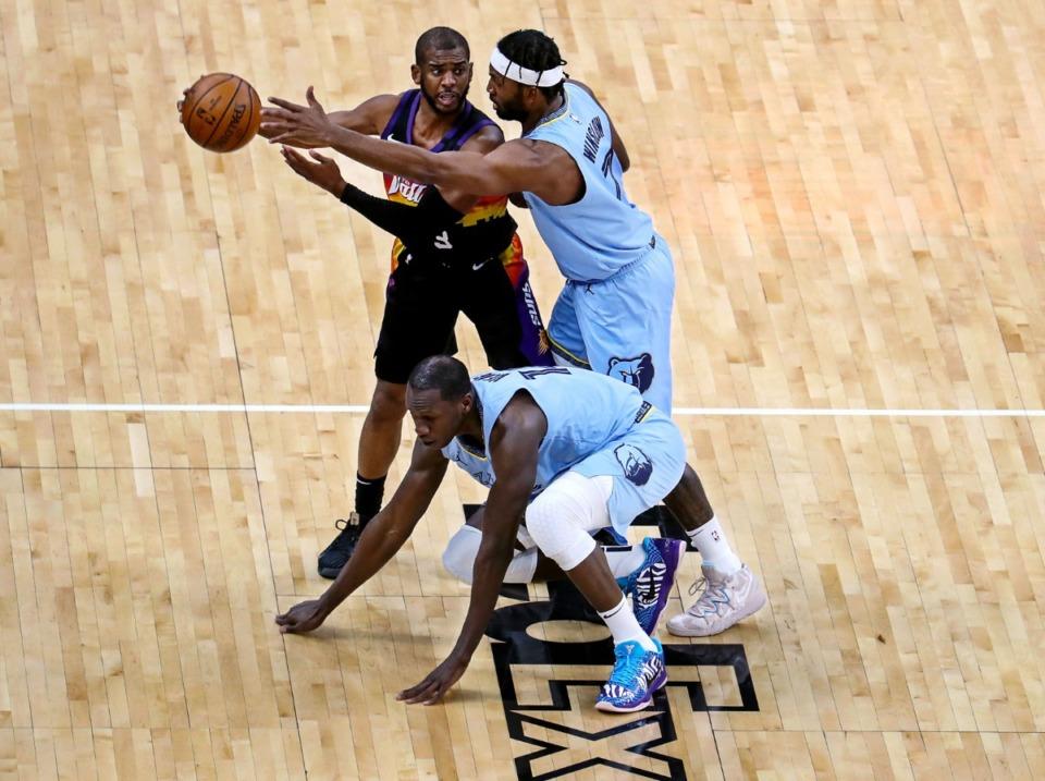 <strong>Memphis Grizzlies forward Justise Winslow (7) and center Gorgui Dieng (14) trap Phoenix Suns guard Chris Paul (3) during a Feb. 20, 2021 game at the FedExForum.</strong> (Patrick Lantrip/Daily Memphian)