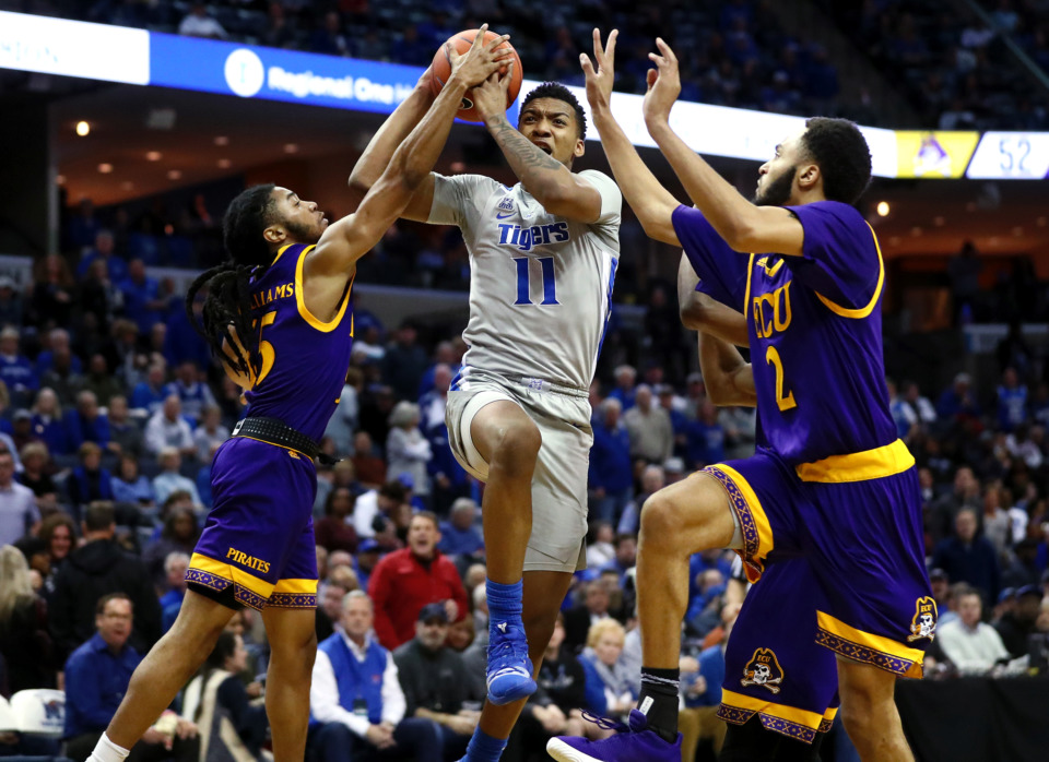 <strong>Tigers guard Antwann Jones (11) charges the lane for a lay-up against East Carolina University.</strong> (Houston Cofield/Daily Memphian)
