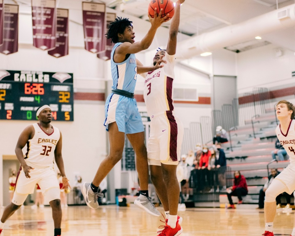 <strong>Northpoint guard Christian Gililland (2) goes up for the shot during a playoff game at ECS on Sunday, Feb. 21, 2021. ECS moves on in the tournament after beating Northpoint, 45-27.</strong> (Houston Cofield/Special To The Daily Memphian)