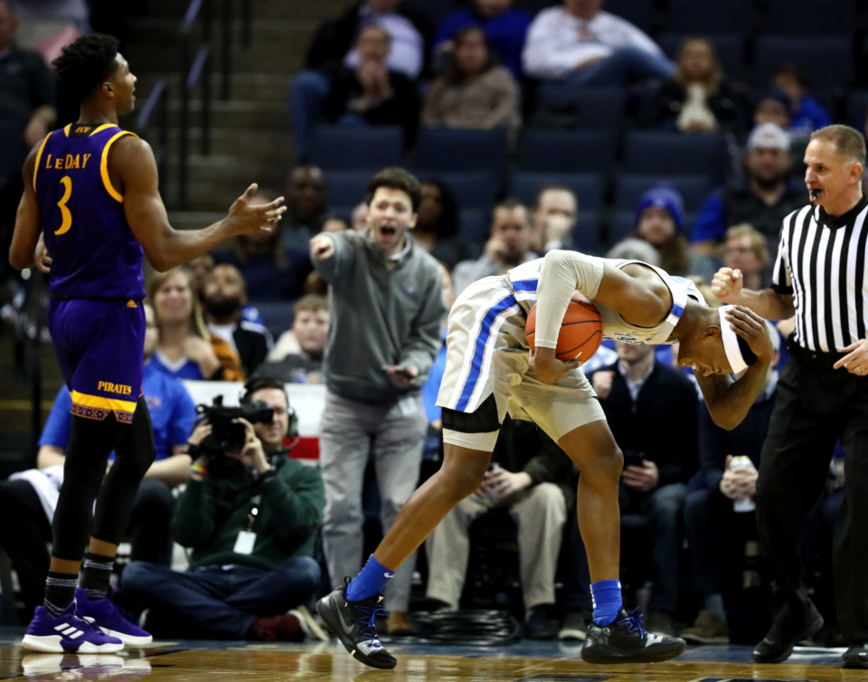 <strong>University of Memphis Tigers forward Kyvon Davenport (0) holds his head after being fouled. The Tigers came out on top winning 78-72.</strong> (Houston Cofield/Daily Memphian)