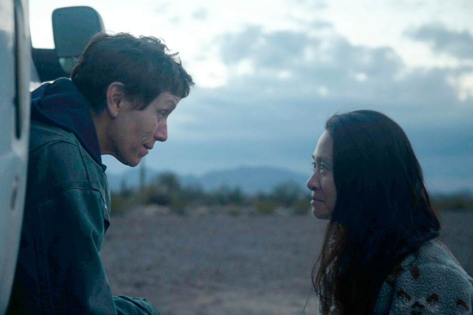 """<strong>This image released by Searchlight Pictures shows Frances McDormand, left, and director Chloe Zhao on the set of """"Nomadland.""""</strong> (Searchlight Pictures via AP)"""