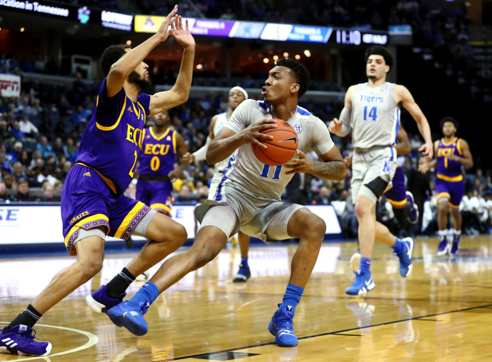 <strong>Memphis guard Antwann Jones (11) drives through the lane against East Carolina University on Thursday, Jan. 10, at FedExForum. The Tigers won 78-72.</strong><span> (Houston Cofield/Daily Memphian)</span>