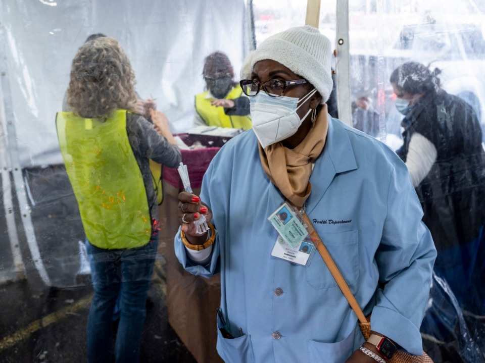 Retired nurse Rita Johnson helps as Shelby County Health Department personnel and volunteers administer COVID-19 vaccinations on Sunday, February 21, 2021 at Southwest Tennessee Community College - Whitehaven Center. <strong>(Brad Vest/Special to The Daily Memphian)</strong>
