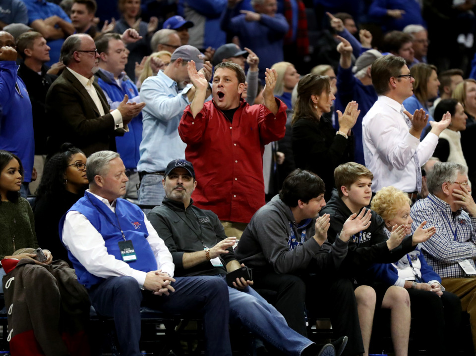 <strong>Memphis fans cheer as guard Tyler Harris lands a long-range three-point shot against East Carolina University on Thursday, Jan. 10, 2018.</strong> (Houston Cofield/Daily Memphian