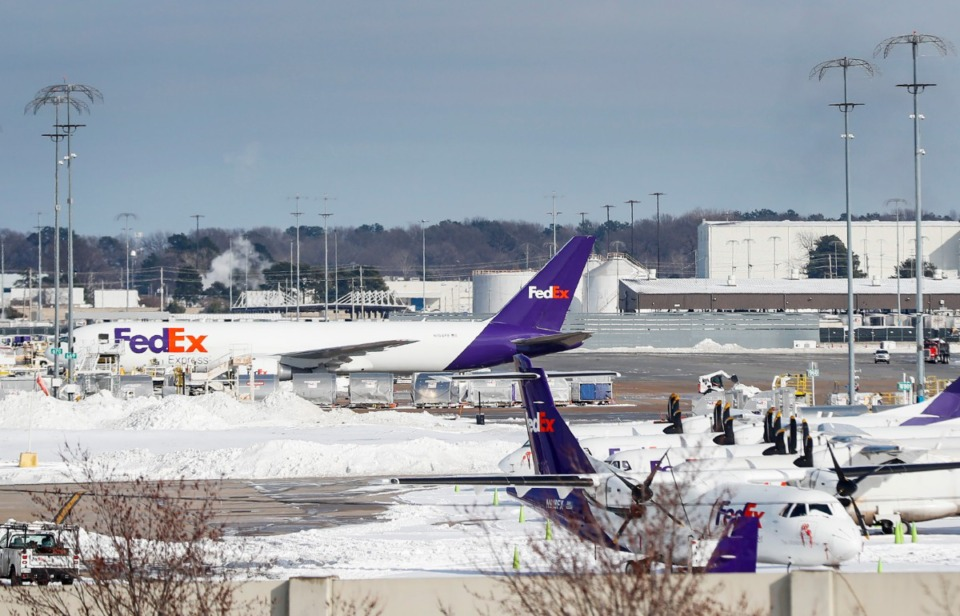 <strong>Snow surrounds FedEx planes on Tuesday, Feb. 16, 2021, at the Memphis International Airport.</strong> (Mark Weber/The Daily Memphian)